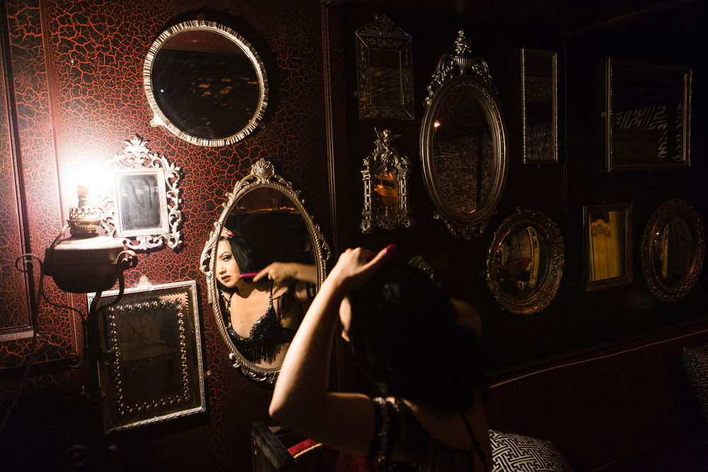 Burlesque dancer Eliza DeLite prepares for a show.  London, UK