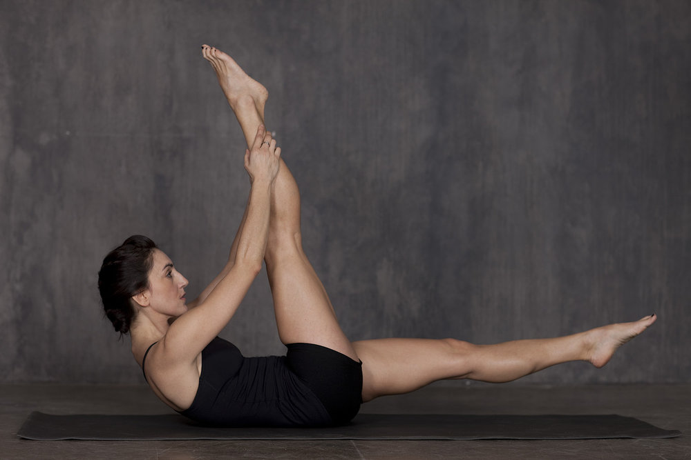 Karrie Adamany beautifully executes the Pilates exercise Single Straight Leg Stretch.