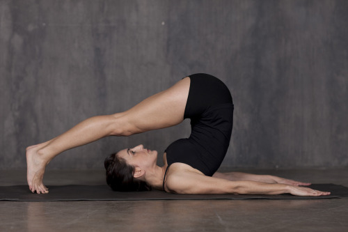 Karrie Adamany beautifully executes the Pilates exercise The Roll Over.