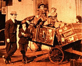 From Left : Joe, Buster, Harry (Jingles),  Louise & Myra Keaton with their hotel and stage trunks  heading for the big time, c. 1910.