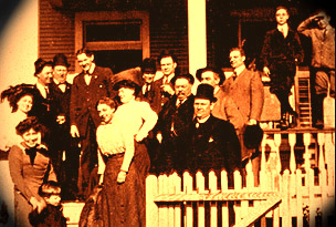 The vaudeville colony in Muskegon :  Buster is up on the balustrade,  second from far right, c. 1910.