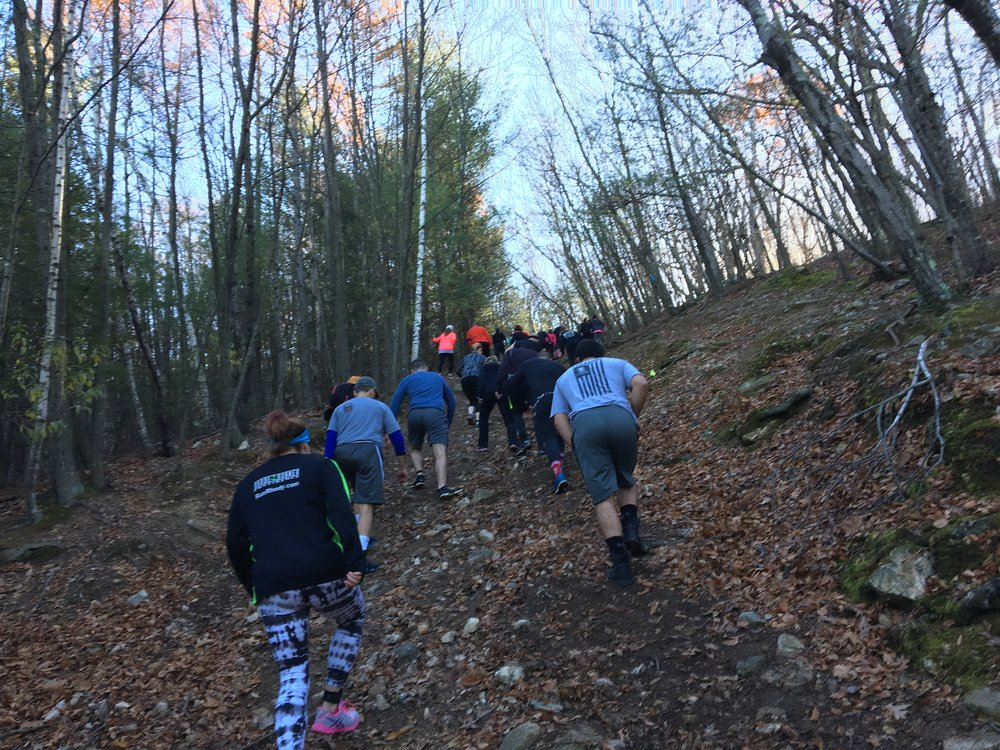 Racers face the first in a series of incline marches at F.I.T. Challenge in Rhode Island, just moments after starting the course. Photo Credit: Joe Crupi