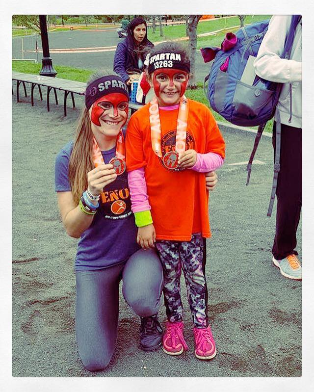 "Spartan Race Brand Ambassador Katie Purcell and her ""Mini-Me"" Theresa."