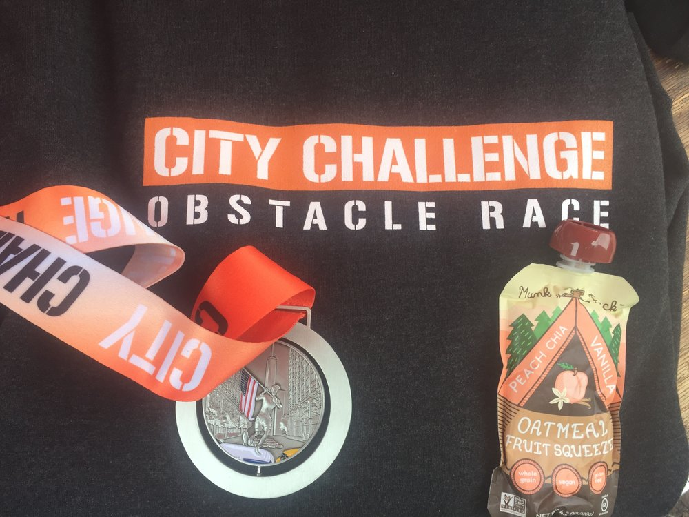 A sweater, a MunkPack and the City Challenge Race Finisher medal.