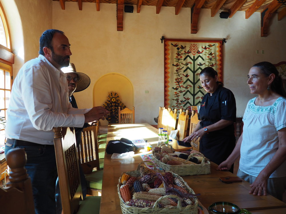 Rafa explaining to head gardener Salvador, chef Denise and owner Sarah Livia. Photo by Jackie Bryant.