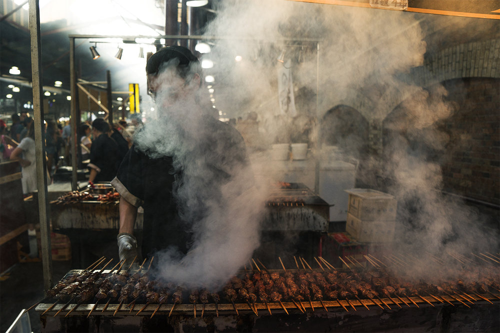 Smoke rises at the Summer Night Market, Queen Victoria Market, Melbourne. Photo credit: Nick Walton-Healey.