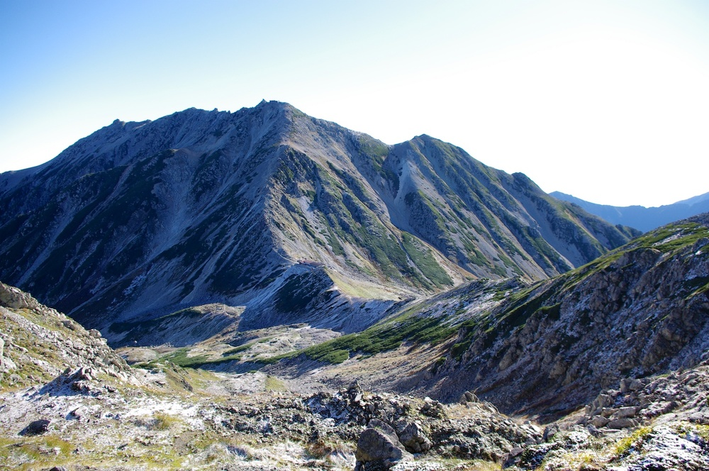 The view of Mt. Tate from Mt. Jodo. The building in the valley is the Ichinokoshi emergency hut.  Taken 9.24.2011