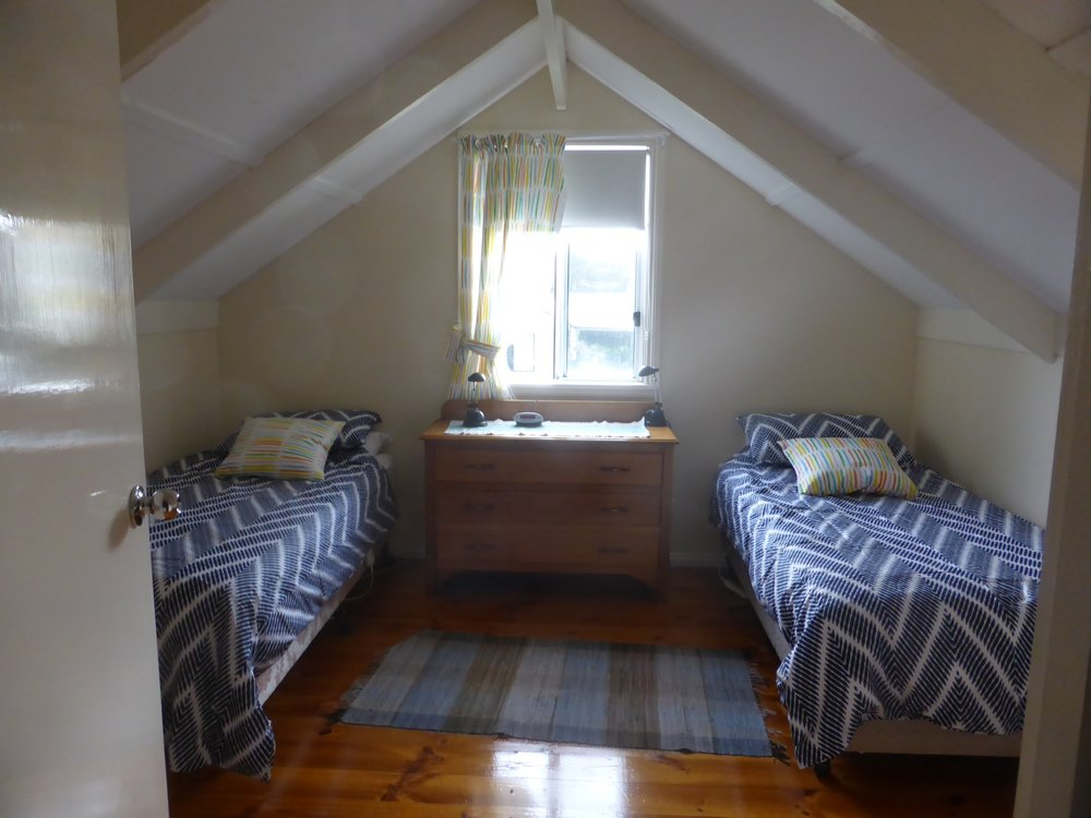 Attic bedroom for kids, tucked away from the oldies