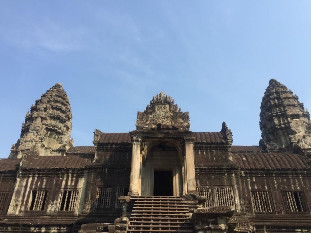 Standing below Angkor Wat