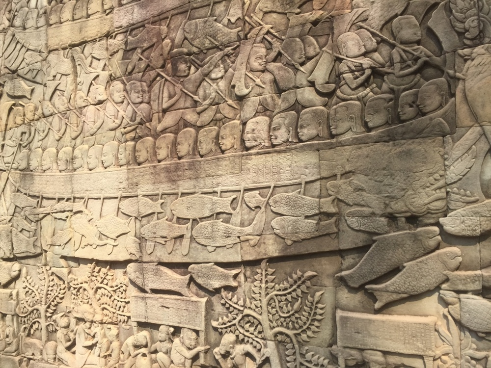 Beautiful murals adorn the walls of the Bayon