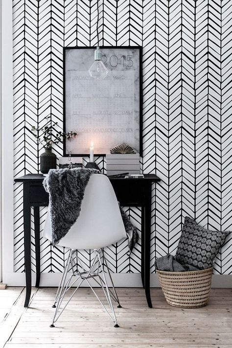 geometric wallpaper with white chair