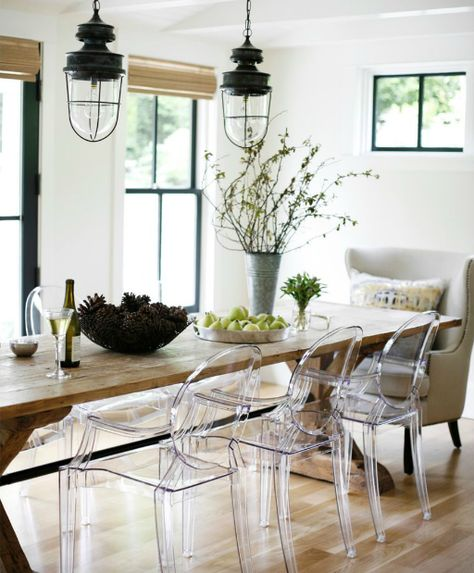 wooden table with acrylic chairs