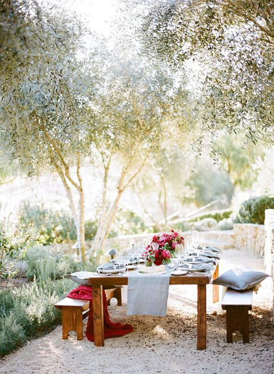 Table setting underneath trees