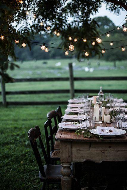 table underneath fairy lights