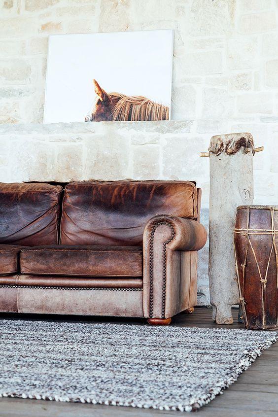Leather sofa with grey rug