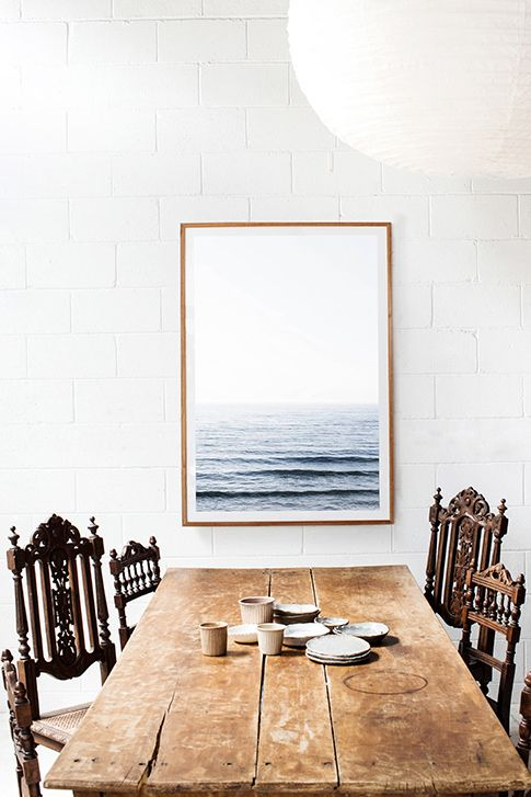 wooden table with seaside picture