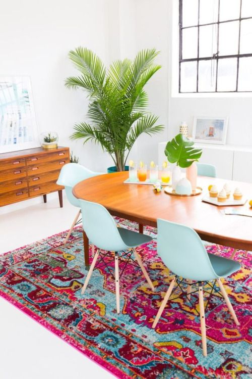 Blue dining room chairs with pink rug