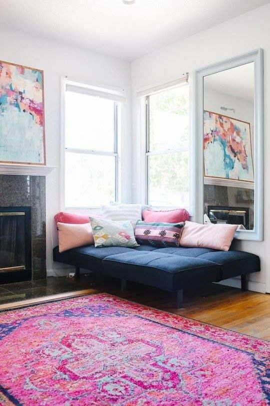 Pink persian rug with blue sofa