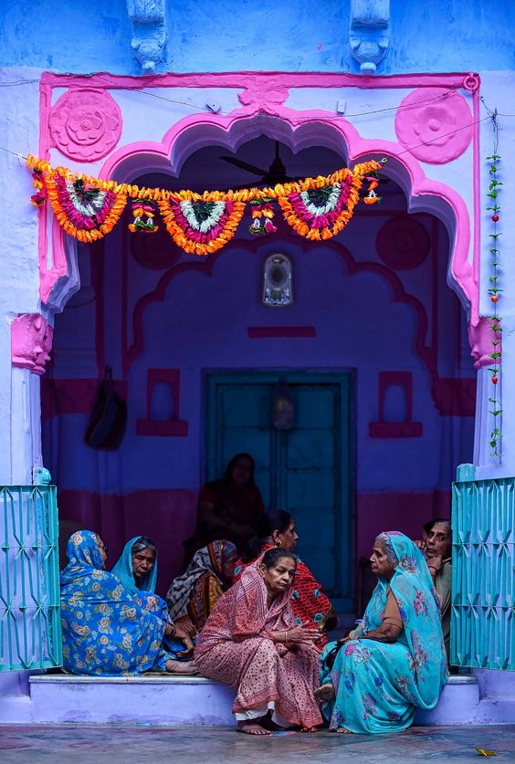 Indian ladies and blue and pink walls