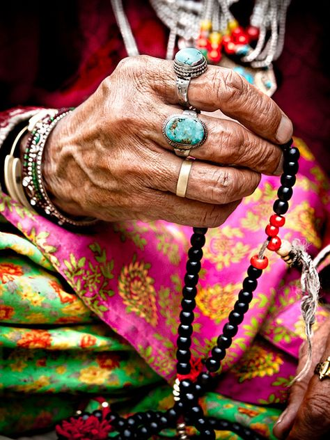 woman with blue stone ring and bright colours