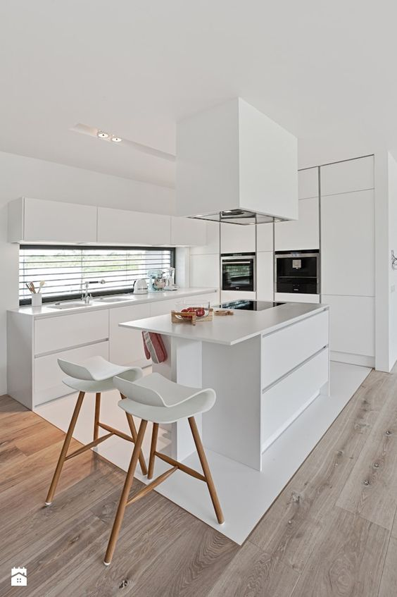 white kitchen with bar