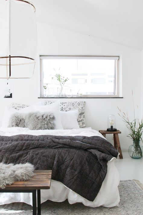 Grey and white bedroom with blind