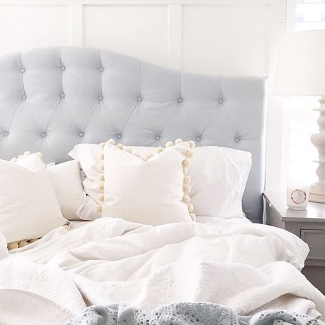 light blue headboard with white duvet