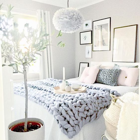 Pale blue throw in bedroom