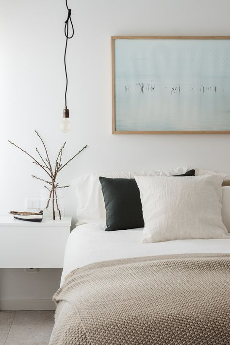 light brown bedroom with white sheets