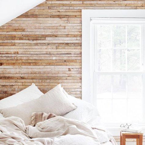 wooden wall with linen bed