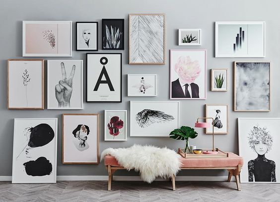 Large gallery wall with photographs and art