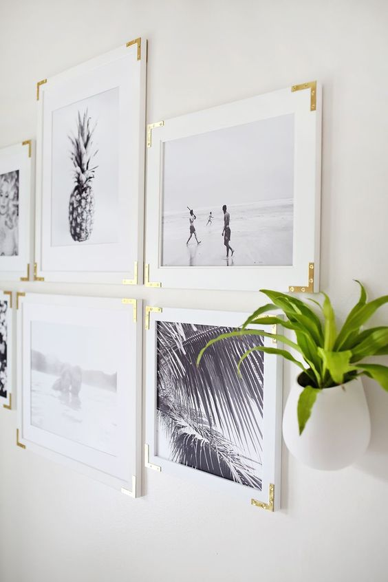 white gallery wall with gold frames