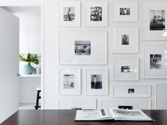 White frames with black and white photos wall