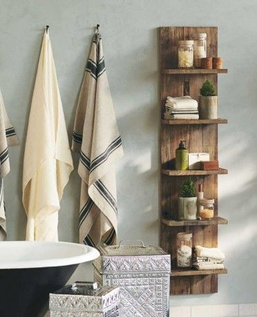 bathroom with thin floating shelves