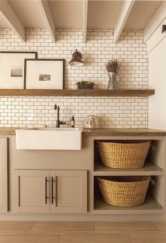 Laundry room with floating shelf