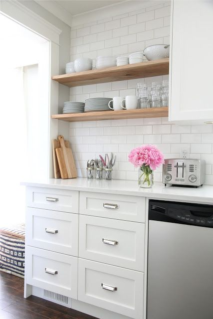 kitchen with wooden floating shelves
