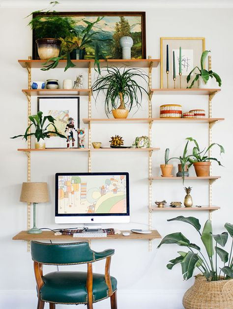 Study room with green plants and floating shelves