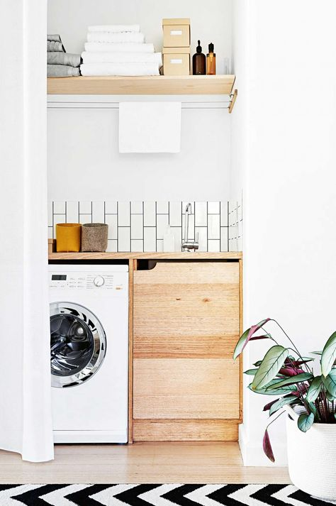 Laundry room with wooden floating shelf