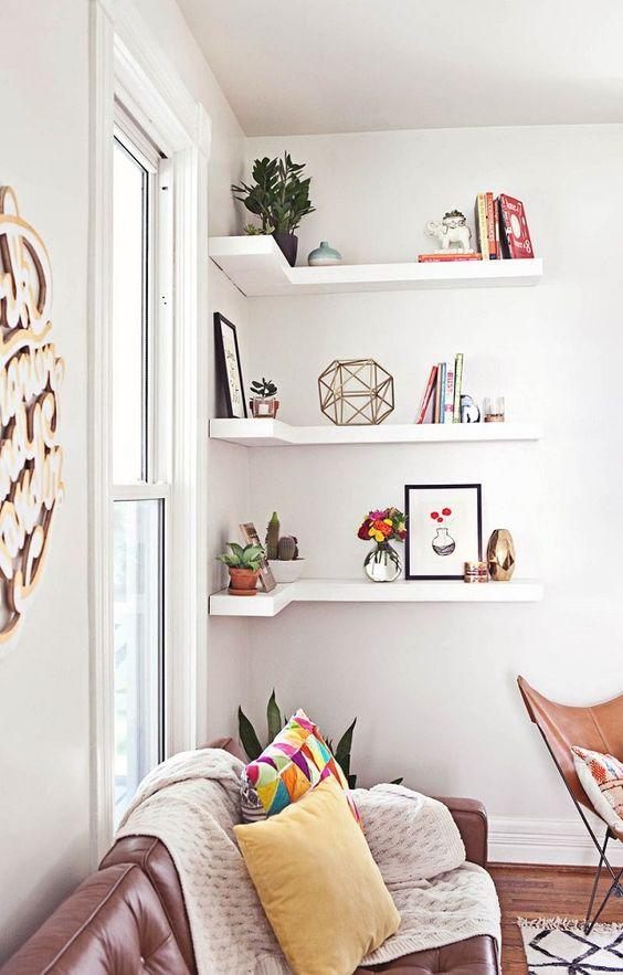 Corner floating shelves in white living rooms