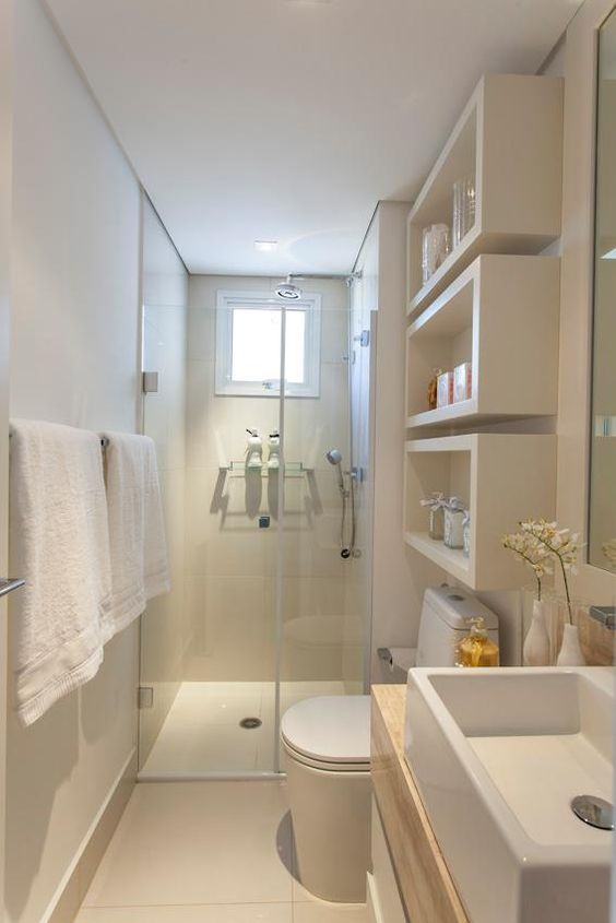 bathroom with white floating shelves