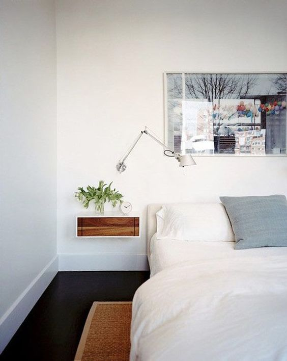 bedroom with floating side table