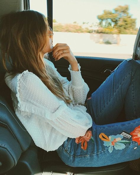 Embrace your inner hippie with faded jeans that have embroidered flowers on the side panel.