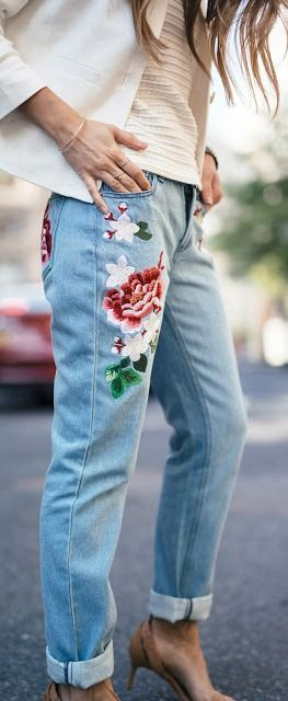 A soft, delicate patterned jeans paired with plain white T and neautral shoes