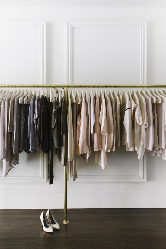 closet with hanging clothes