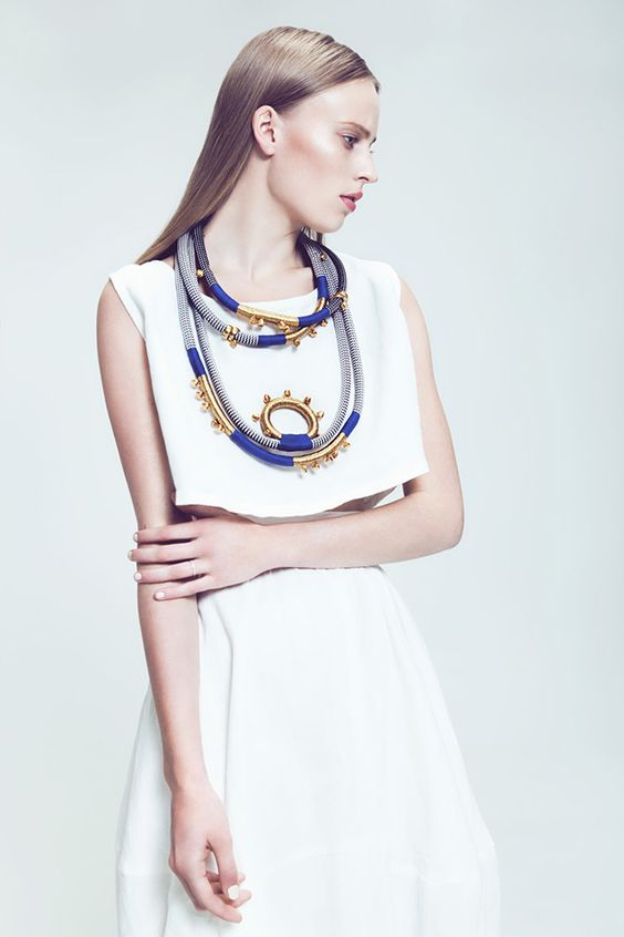 Another Pichulik statement piece that adds excitement to an otherwise simple white dress. It's all about balance.