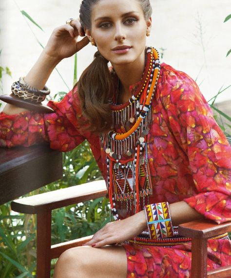 Olivia Palmero with a beautiful statement necklace and beaded bracelet.