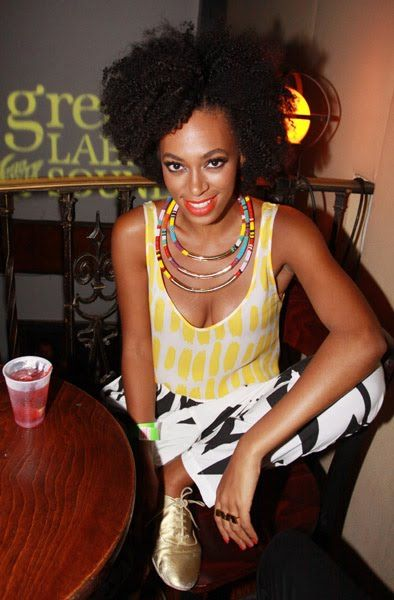 Solange Knowles sporting an elegant gold necklace with bright beaded parts.
