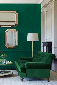 green wall and sofa