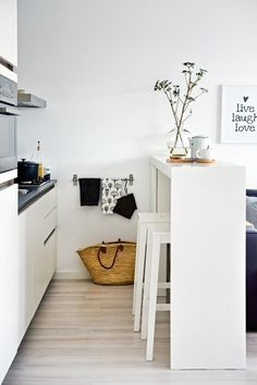 small kitchen with stools