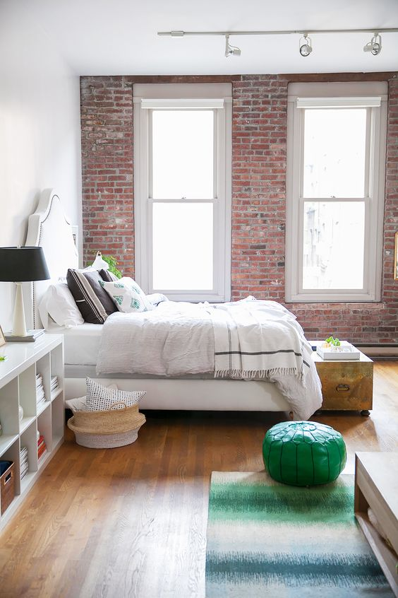 exposed brick wall in bedroom